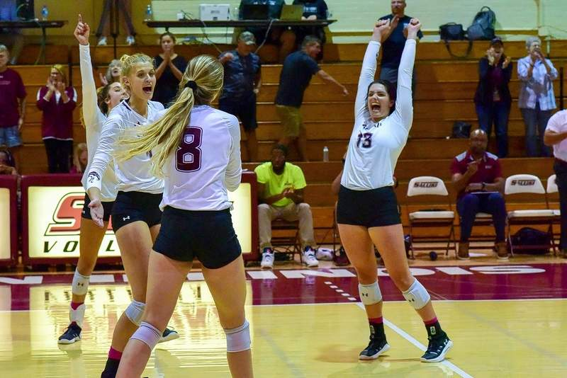 SIU players celebrate after winnin a match against Drake Friday.