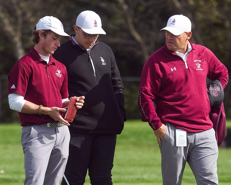 October 18, 2019 - Normal, IL - Benton's Brad Hammond and Collin Miller talk with first year assistant coach Wade Thomas during a break in the action while playing at Weibring Golf Course on Friday during the IHSA State Class 2A Golf Finals.