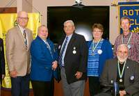 Shown from left to right are John D. Aiken, Larry Lewis, Rotary District Governor Gary Hamm, Ron Giacone, Rhonda Gilbreath, Gary Messersmith, Steve Woodfin and Dave Cooper.