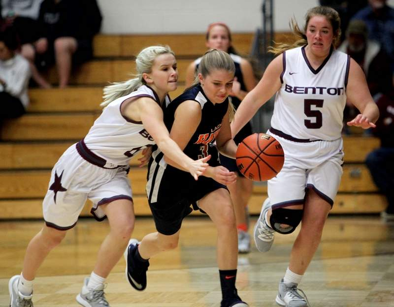 Benton's Jacey Eubanks applies pressure to Gallatin County guard Gracie Sauls in Monday night's season opener for both ball clubs. Trailing on the play is Rangerette's Zoe Carlton (5). Benton won 55-27.
