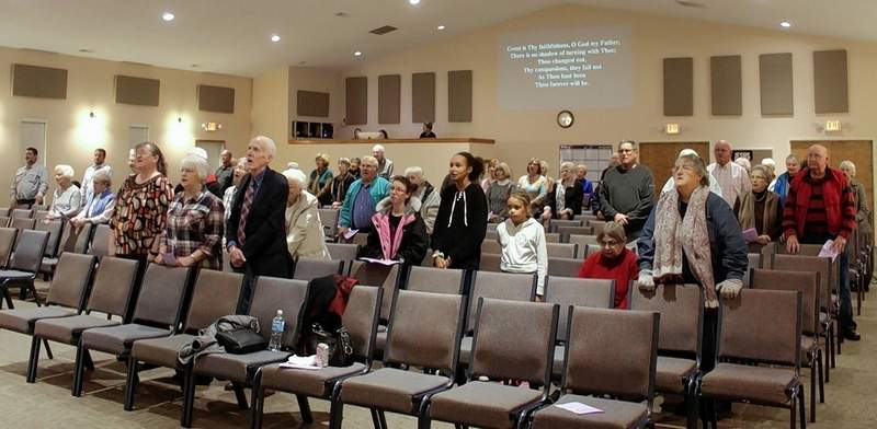 "The Thanksgiving Service congregation joins in singing ""Great is Thy Faithfulness."""