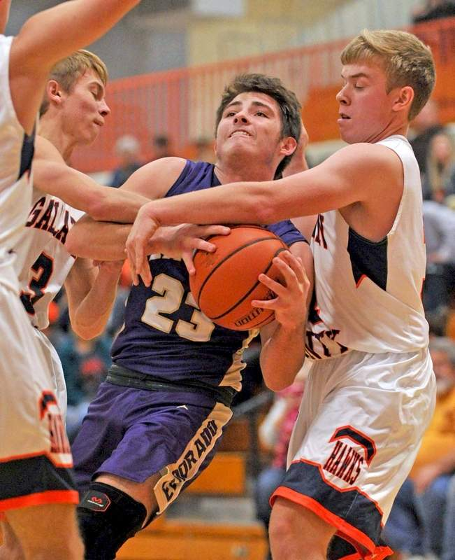 Eldorado's Hunter Sizemore, tries to split Gallatin defenders Will Henson (left) and Brock Seely (right) on his way to the basket Friday night.