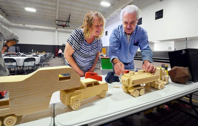 Marion Third Baptist Church member Don Chamness was busy setting up the hand made wooden toys he made that he donated to the Women's Ministry of the church for a silent auction Saturday at their annual Christmas Extravaganza. Cindy Bogard was getting a closer look at Chamness' handiwork.
