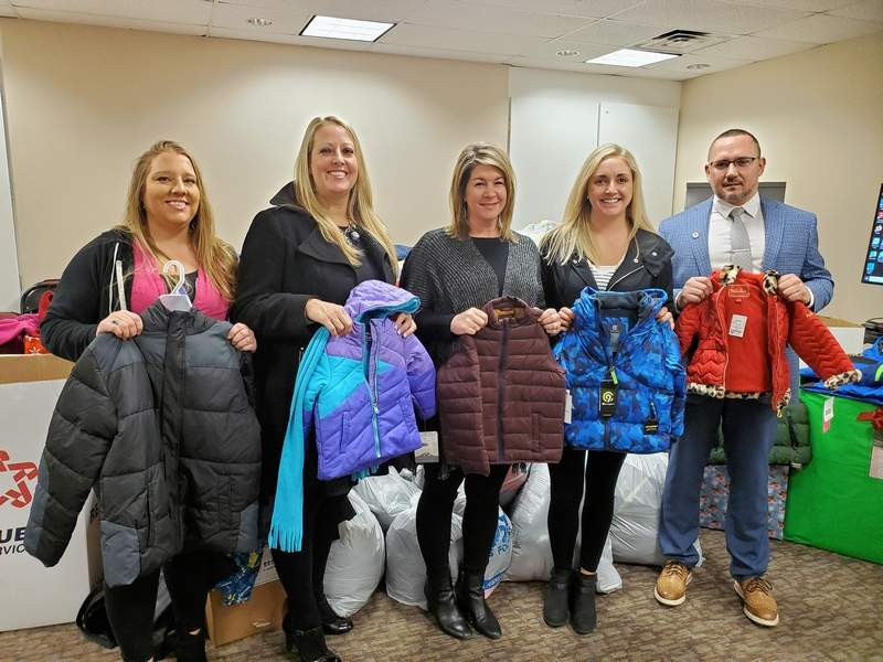 Rotary members, from left, Amber Phillips, Kelly Caudill, Brttney Neal, Julie Campbell, and Jason Powell with some of the 650 coats collected in the 2019 coat drive.