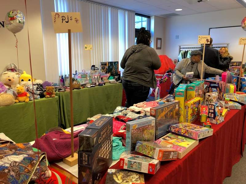 """Social workers """"shop"""" to fill lists for children who are victims of abuse, neglect, and abandonment at the Poshard Foundation annual Christmas toy giveaway at John A. Logan College on Wednesday."""