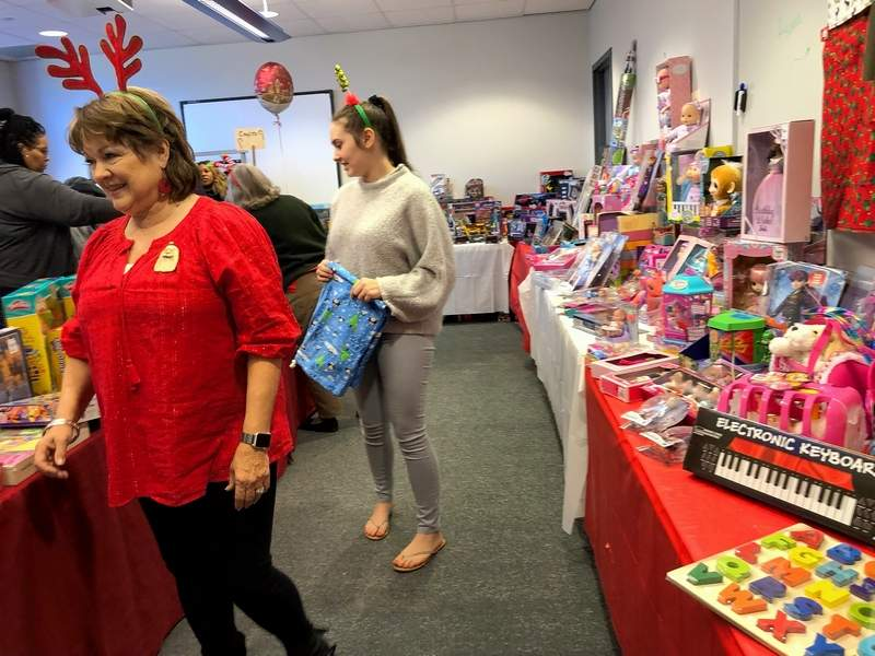 """Carol Haven, front, and her granddaughter, Jayden, are two """"elves"""" who help make the Poshard Foundation toy project a success."""