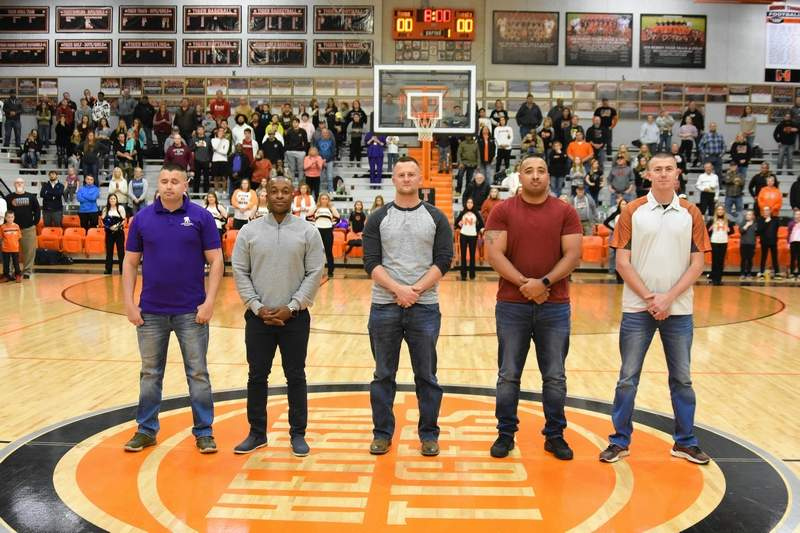 Herrin High School honored former athletes, from left, John Giacone, Kent Sherrel, Tim Downen, Marshall Anderson, and Garrett Lukens on Friday evening prior to the start of the basketball game against Harrisburg. The five former Tigers are among over 400 area soldiers set to deploy as part of Operation Freedom's Sentinel this afternoon after a ceremony at the Banterra Center in Carbondale.
