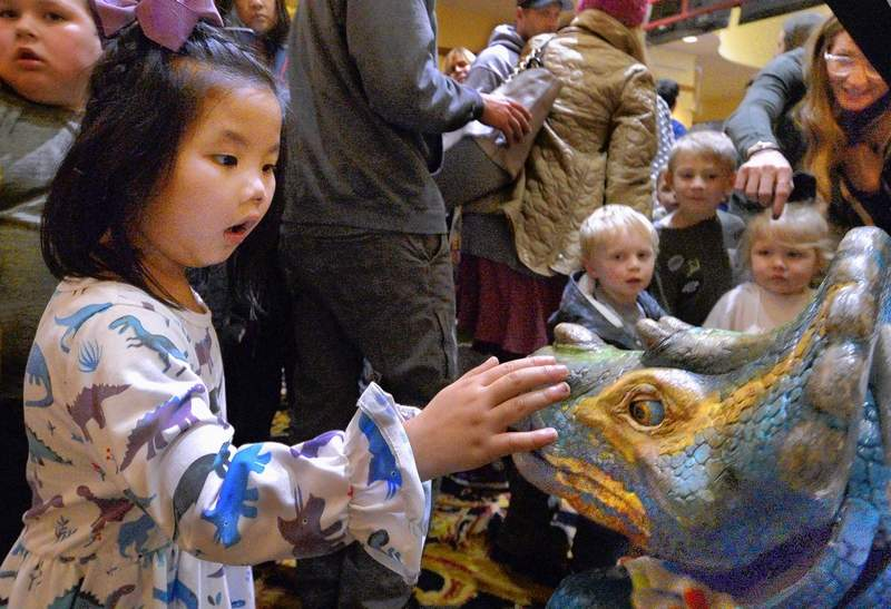 "The Dinosaur World Live show at the Marion Cultural & Civic Center last Thursday was an exciting experience, especially for the youngsters in the crowd. This young lady seemed to be enthralled and excited to get to ""pet"" one of the smaller dinosaurs while exiting the theater."