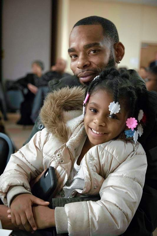 LEFT: Sincere Curry and his daughter Serenity of Marion joined several others on Monday for the Rev. Dr. Martin Luther King Jr. Celebration at Marion Pavilion.