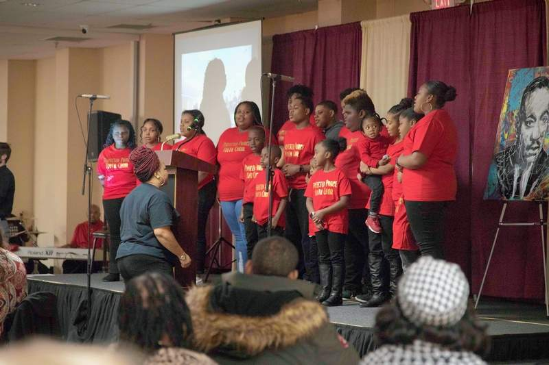 Refuge Temple Choir Children's Choir performed two songs Monday for the Rev. Dr. Martin Luther King Jr. Celebration at Marion Pavilion hosted by Boyton Street Community Center.
