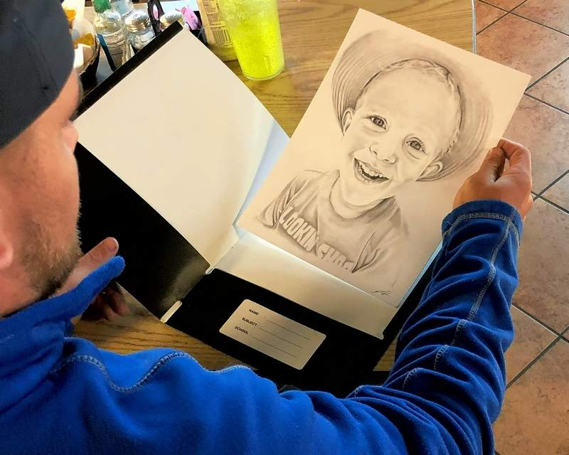 Another view of Josh studying the portrait of my grandson, Hudson.