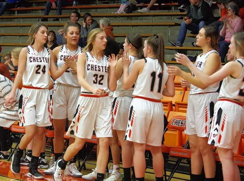 Lady Jackets Reese Chandler (24) and Josie Kattenbraker (32) are greeted by fellow players Kailyn Asbsher (25), Trinity Brown (31), Kendall Williams (11), Alyssa Seymour (44), and Peyton Clendenin (25) as they return to the bench after coming out of the game. The Jackets led 59-18 at that time.