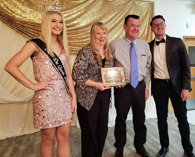 Joanne and Donnie Toler, center, owners of the iconic Toler's Do-It-Best on Main Street, are honored as the Du Quoin Business of the Year on Saturday night. Dane Mason, at right, presented the award. With them on stage is Miss Du Quoin, Raylee Carroll