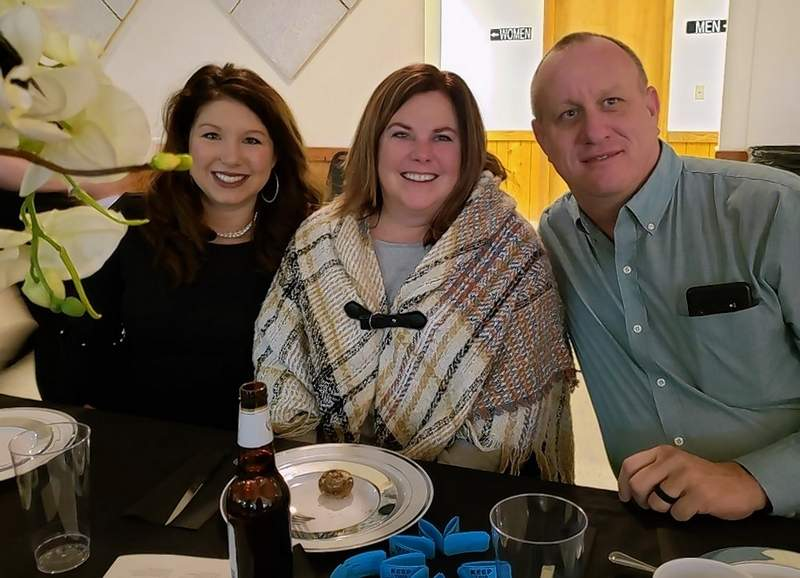 Jessica Holder, left, a member of the chamber board, has dinner alongside Trisha and Brad Hirte, owners of Emling's Towing in Pinckneyville.