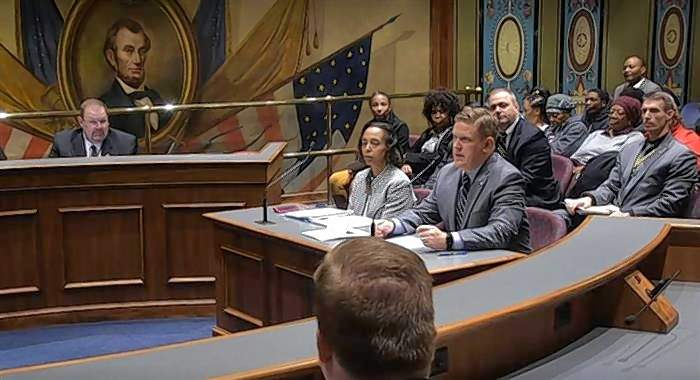 Illinois State Police Director Brendan Kelly and Robin Woolery, the assistant deputy director for the agency's forensic science department, testify Tuesday in Springfield about the backlog of untested forensic evidence.