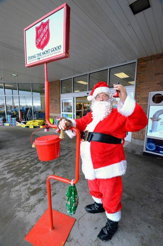 Volunteer Jonathan Lake of Herrin donated a Santa suit Friday to help accept red kettle donations for the Salvation Army at an entrance to the Marion Kroger store.