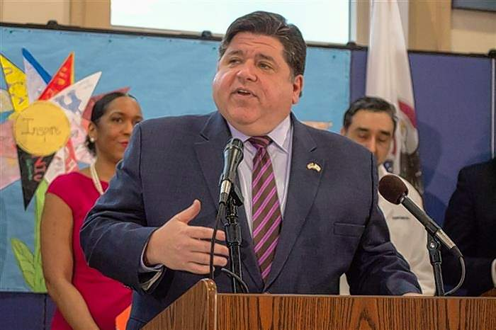 Gov. J.B. Pritzker speaks at Ridgely Elementary School in Springfield on Wednesday to announce the release of the first phase of funding for a grant program to increase broadband internet access in the state.