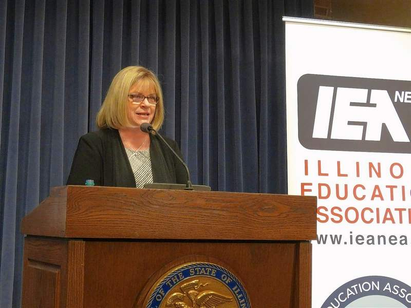 Kathi Griffin, president of the Illinois Education Association, discusses a new survey about attitudes toward Illinois public schools during a news conference Tuesday at the Capitol in Springfield.
