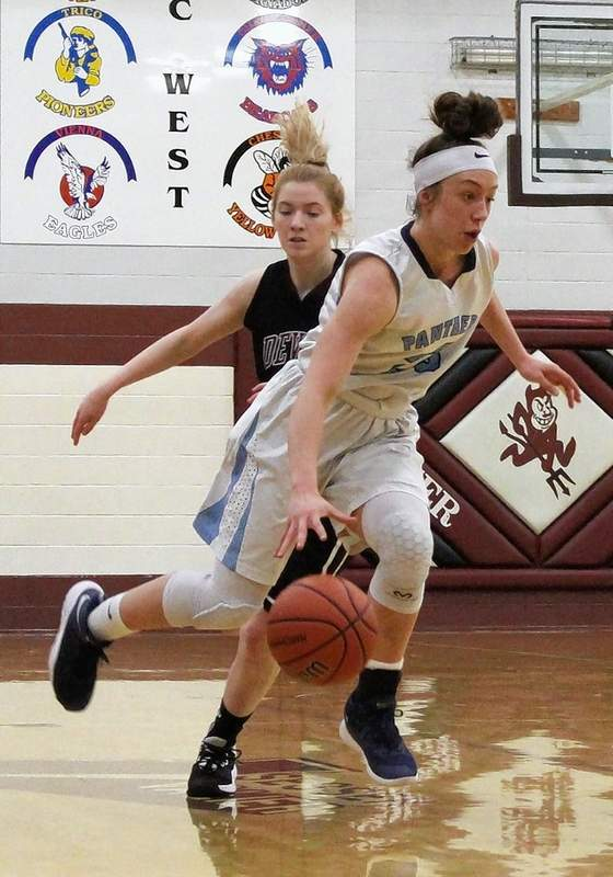 Kenzie Rushing powers toward the basket for two of her 30 points.