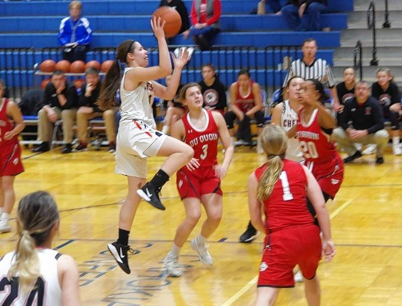 Chester Senior Trinity Brown soars to the basket against Du Quoin, greeting Lady Indian defenders Lauren Heape (3), Abbi Mocaby (1) and Loveleen Dunkin (20) along the way. Brown made the shot.