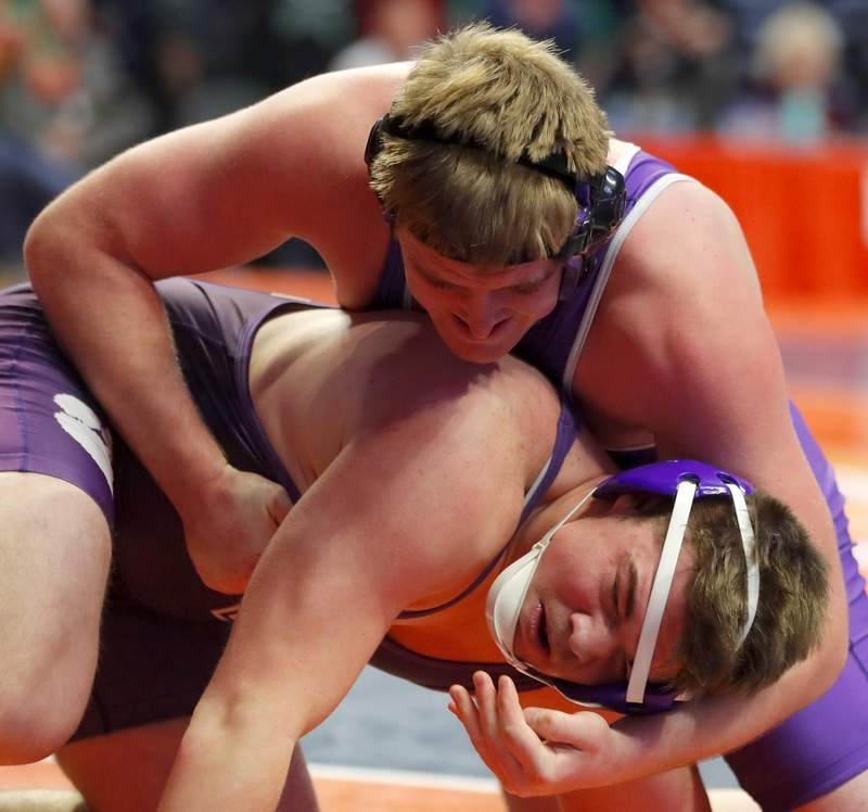 Harrisburg's Tucker Bryant, top, battles Wilmington's Nick Gornik in a 220-pound Class 1A match during the State Final Tournament in Individual Wrestling on Friday at State Farm Center on the campus of the University of Illinois in Champaign.