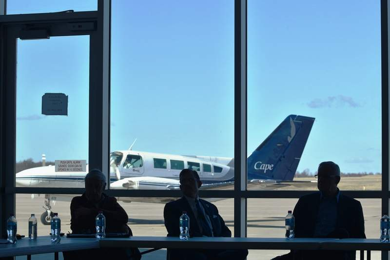 During a meeting to discuss a Chicago-to-Marion direct flight route at Veterans Airport Friday, a Cape Air plane taxis past the meeting room.