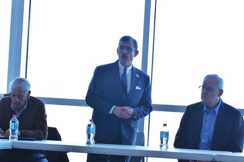 Marion Mayor Mike Absher, standing, discusses a proposal for a Chicago-to-Marion flight at a meeting at Veterans Airport. Carbondale Mayor Mike Henry, right, and Herrin Mayor Steve Frattini, left, have been working in conjunction with Absher to encourage the idea.