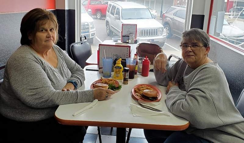 """Theresa Johnson, left, and Kathy Hamburger, have one final meal at Kalin's Cafe on Monday. Asked about the coronavirus shutdown, Hamburger said, """"Biggest hype there ever was."""""""