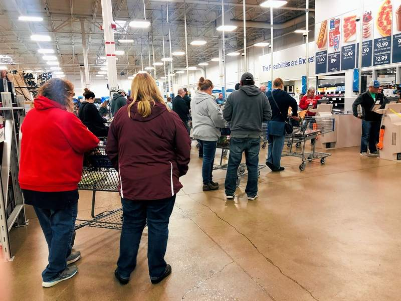 """Soon after Governor J.B. Pritzker announced the""""shelter in place"""" order, long lines quickly formed at Sam's Club in Marion."""