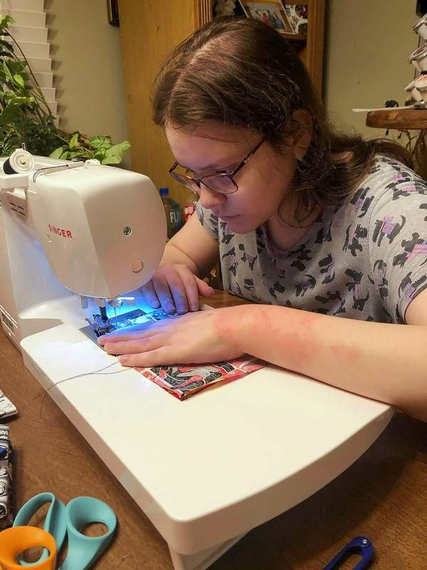 Sabryna Richards of Marion is using her time off from school to sew CDC-compliant masks she plans to donate to are hospitals and medical personnel.