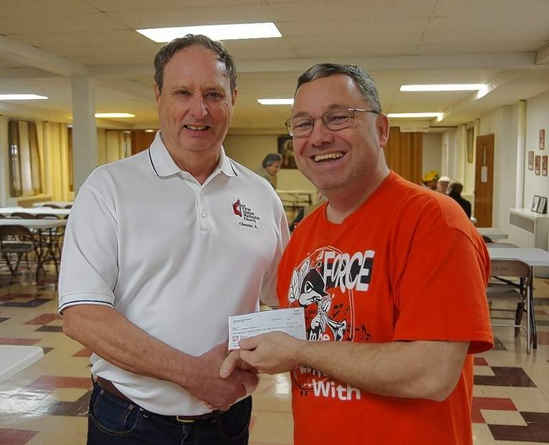 Judge Richard Brown, First United Methodist Men treasurer, left, presents the check to Steve Colonel, Chester High School Band Director.