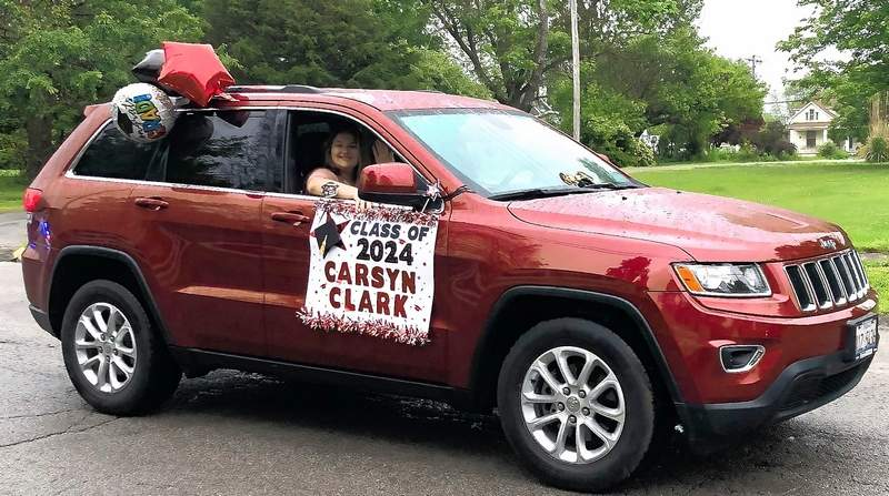 Carsyn Clark was all smiles as she rode in the promotion parade for the Johnston City Middle School on Wednesday. Carsyn had reason to smile. Along with her promotion certificate, she also received awards for Honor Roll, Perfect Attendance, Hall of Honor, Scholar Bowl, and Top Student.