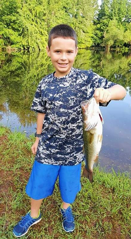 Logan Smith is no stranger to farm pond fishing where he landed this big catch.