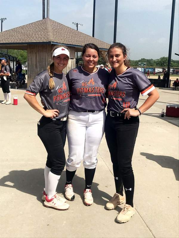 Former Harrisburg standout and Southeast Missouri State University freshman Karsyn Davis (right) is spending her summer weekends in Kansas City, Missouri, playing softball with two of her Redhawk teammates Kimmy Wallen (left) and Payteince Holman.