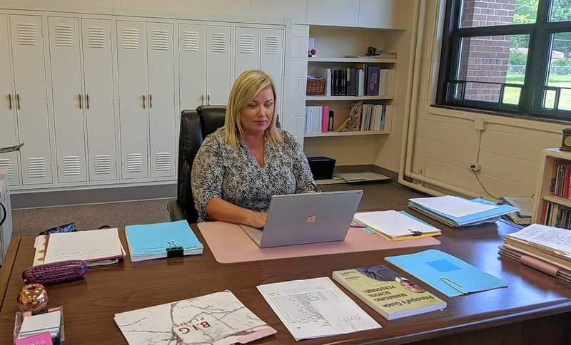 Janice Pavelonis, District 95's assistant superintendent of curriculum and instruction, works on final copies of the new curriculum maps for grades pre-K to eighth.