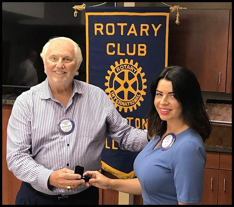 Hilary Remm receives a Past President's pin from Benton Rotary Club member Ken Burzynski. Remm made history for the 98-year-old service club by becoming its first woman president. During her presidency, the club saw an increase in membership, but it also saw the beginning of the COVID-19 pandemic, which brought new concerns about how to keep members safe but still in touch. Remm saw the need for an increase in funding for the Benton/West City Ministerial Alliance, donations to the Benton Public Library for landscaping in the new 'reading garden,' and the Benton Rotary Scholarship and award to Benton senior Mia McLain. The new president of the Benton Rotary Club is Jason Corn.