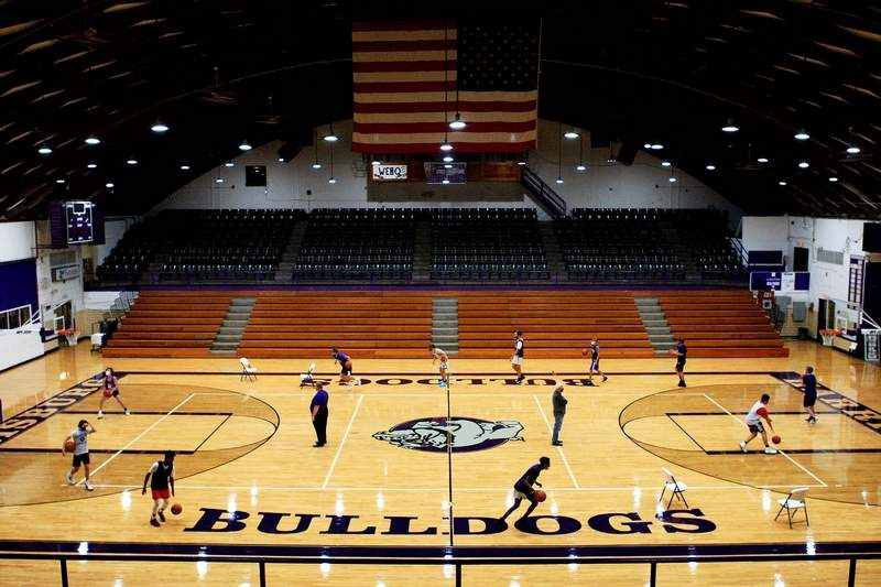 Members of the Harrisburg boys' basketball team run through dribbling drills during an Open Gym Monday inside Davenport Gymnasium. Monday was the official first day of practice in the state of Illinois.