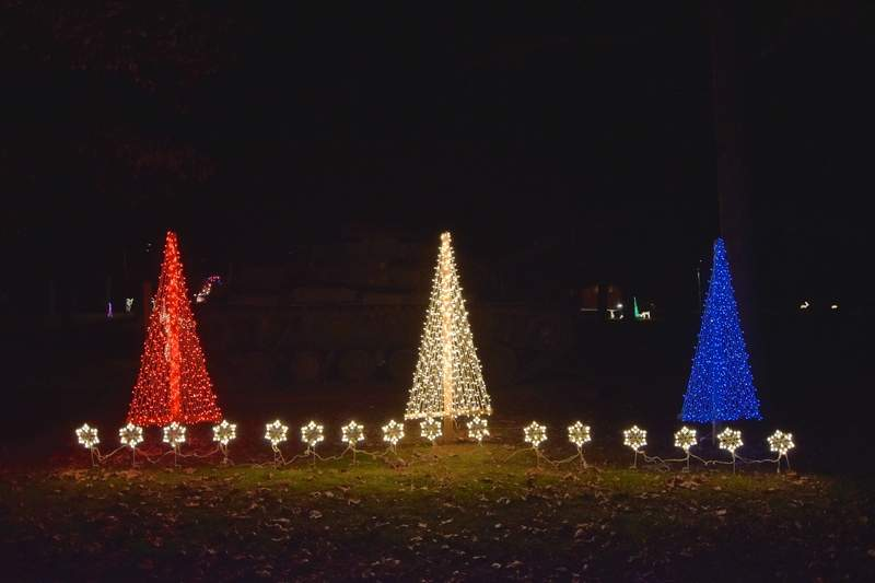 Red, white and blue Christmas trees decorate the scene behind Ridgway Park's tank.