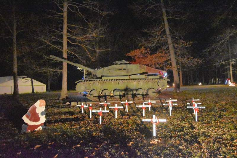 At the Ridgway Park's military tank display, Santa pays tributes to veterans from all U.S. wars.