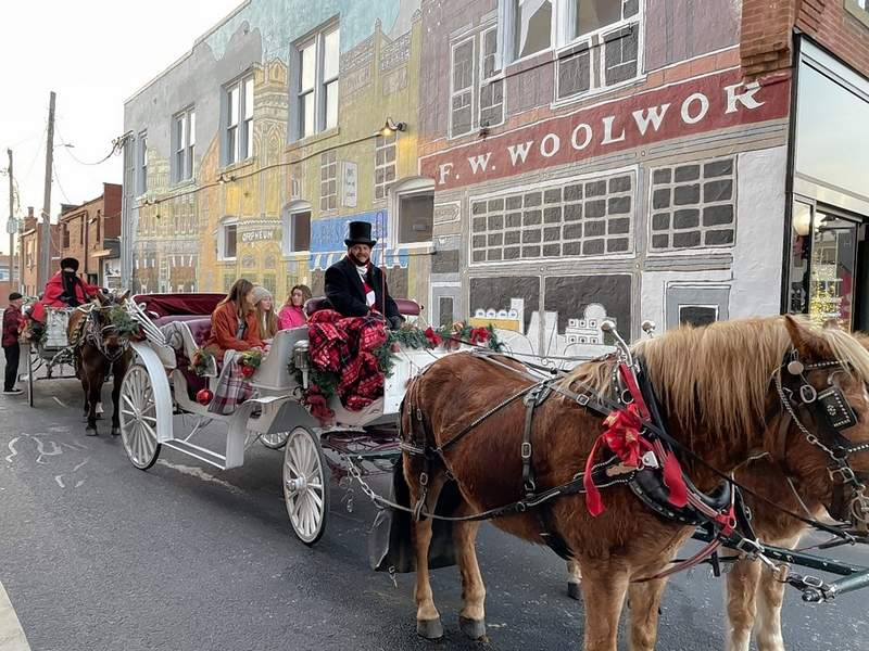 Local residents enjoy a trip back in time with a carriage ride as part of A Very Merry Marion.