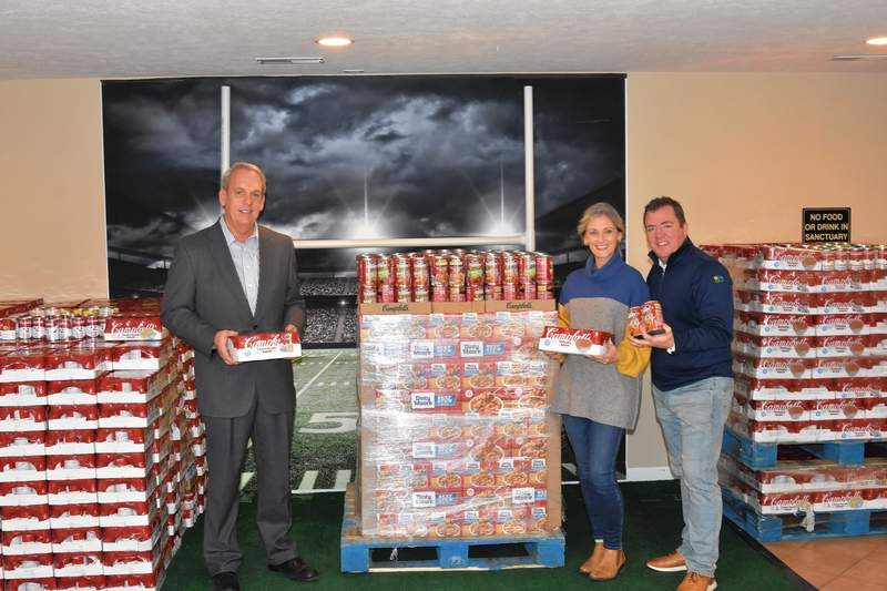 """From left, Sen. Dale Fowler, Pastor Melissa McKinnies, and Senior Pastor Jason McKinnies of the Southern Illinois Worship Center with the first 1,000 cans of soup that kicked off the """"Together We Can"""" drive in Southern Illinois."""