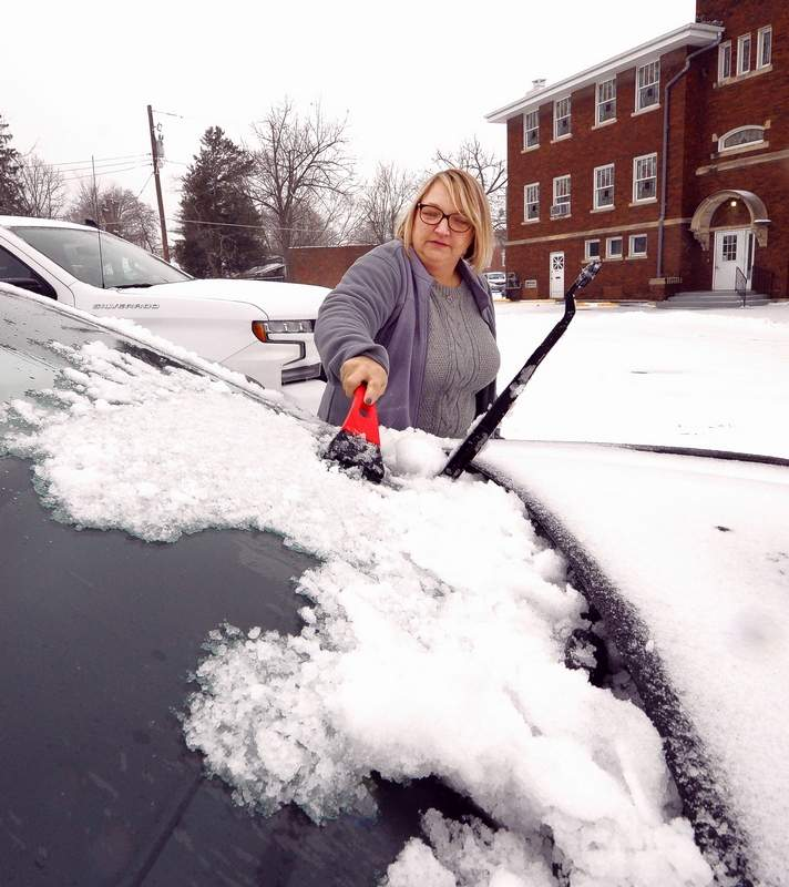 Winter weather came roaring into Benton and most of southern Illinois starting last week, making life more difficult for area drivers like Beth Cunningham, who had to clean her windshield off before heading home after working all day at the Franklin County Clerk's office, which is temporarily located in the Campbell Building. The winter storm also meant various governing bodies had their road crews out and about, around the clock, clearing the roads. This IDOT snow plow is shown clearing the snow and ice along West Main Street in Benton after sunset.