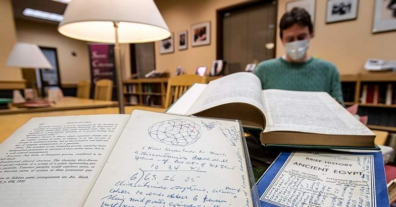 Matt Gorzalski, university archivist, is shown with some of the more than 3,000 books from former SIU Carbondale professor and noted designer and futurist R. Buckminster Fuller. Once catalogued, some of the books will return to Fuller's dome home on South Forest Avenue in Carbondale.
