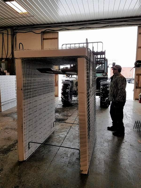 Gerald DeNeal, at right, keeps an eye on an arrangement of EVG 3-D panels as Strata Worldwide member John Will prepares to lift the structure with a forklift.