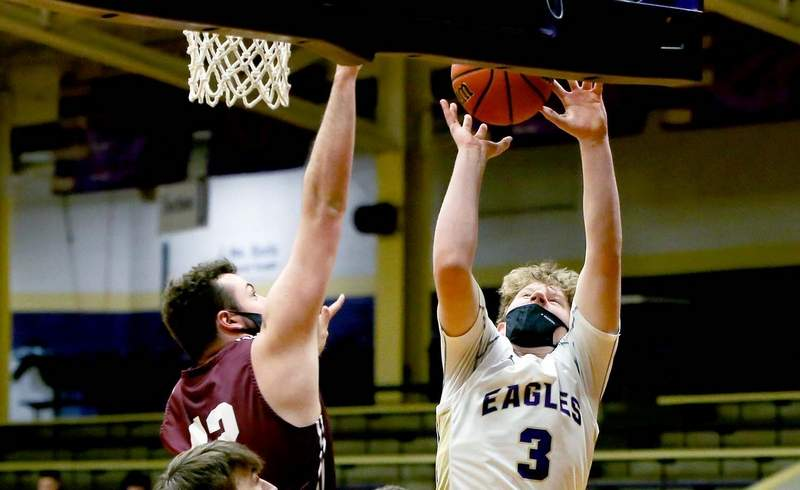 Boston Bradley puts up two of his four points in the Eagles' win over Carmi-White County Wednesday night.