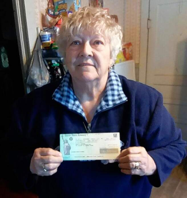 Ruth Carrothers of Du Quoin, with the $1,400 check addressed to her deceased brother, Elvin.