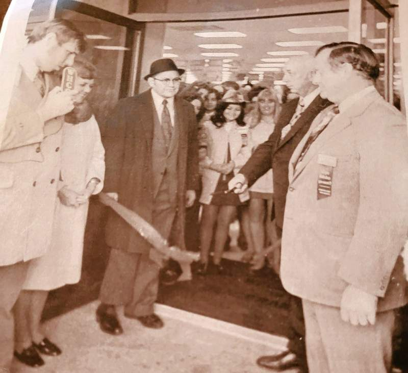 Ralph Kipp, in hat, stands in the doorway of his new Ben Franklin Store in Chester in 1972. At left are Jack Shepar of WHCO Radio and Bonnie Kipp. At right, Mayor Deitz Helmers cuts the ceremonial ribbon.