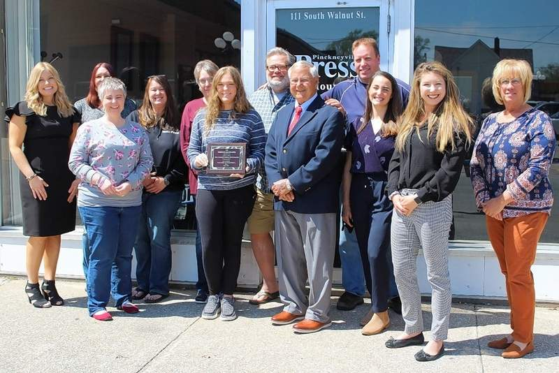 The staff of the Pinckneyville Press/Du Quoin Weekly celebrate their 2021 Business of the Year honor outside the Pinckneyville office last Monday.