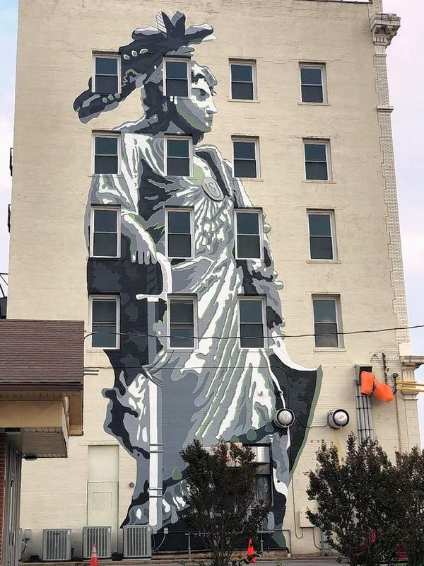 """Marion's latest mural is now complete. Shawn Vincilette, with help from Josh Benson and Luke O'Neill, completed """"Statue of Freedom"""" last week. The mural adorns the side of The Citadel."""