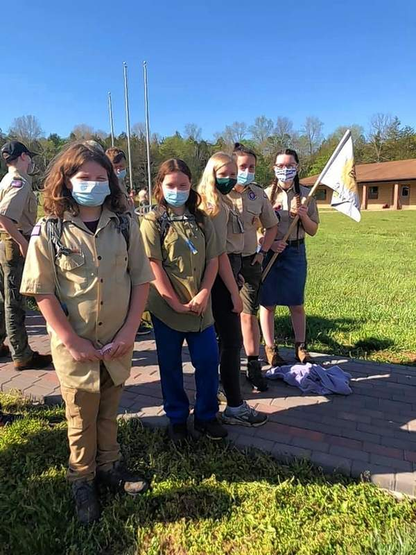 From left, Angelina Carr and Margot Willis of Harrisburg Troop 7023G prepare to participate in the Six District Spring Camporee.